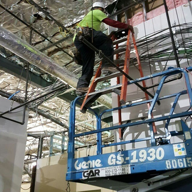 Contractors working unsafely on ladders